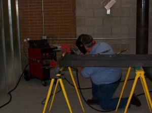 Ryan welding new bearing pedestals on-site