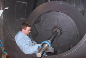 Scott inspecting blower wheel & shaft during a retrofit.